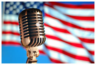 American flag with a microphone