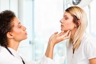 Dr Checking Thyroid.jpg