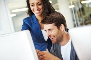 Happy Man and Woman Looking at Computer Screen.jpg