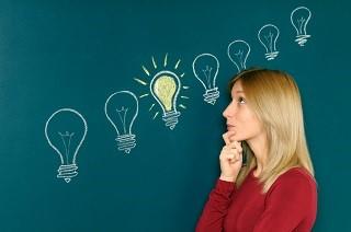 Lady thinking with lightbulbs.jpg