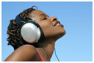 African woman listening to an audiobook