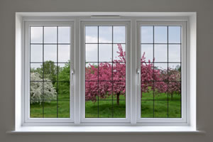 Apple orchard in blossom through leaded glass windows