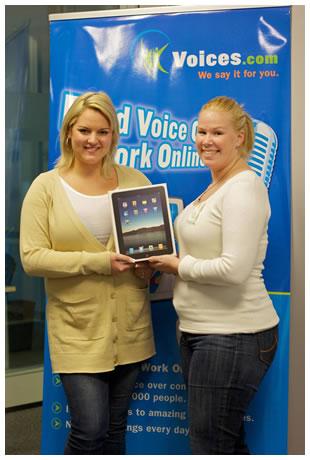 Ashley and Whitney holding an iPad box