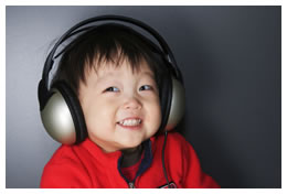 Asian child listening to music