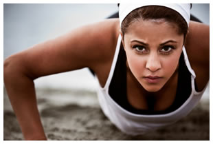 Athletic woman doing a push up outdoors