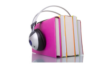 Audiobook Concept - headphones around book stack