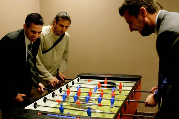 Ben Jackson and friends play Foosball at the Voices.com Grand Opening