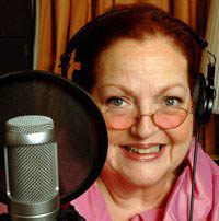 Bettye Zoller smiling set behind her microphone and pop filter