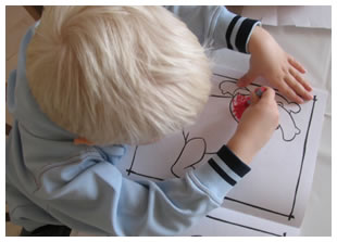 Male toddler coloring