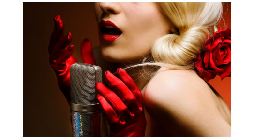 Blonde voice artist wearing red