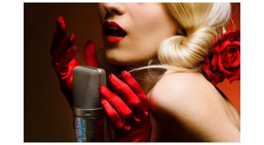 Blonde voice artist wearing red