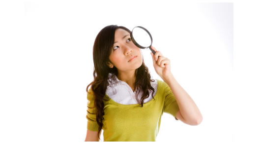 Chinese lady holding a magnifying glass