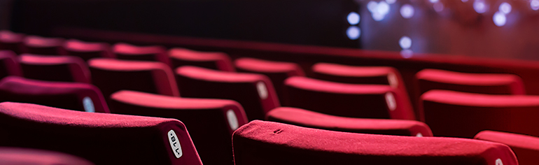 Empty theatre, plush red seats, movies