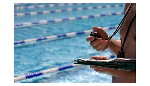 Coach timing swimmer