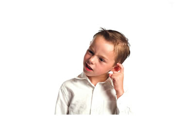 Confused male child touching his ear