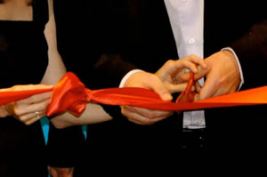 David and Stephanie Ciccarelli cutting the red ribbon at the Voices.com Grand Opening ceremony