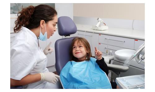 Dental Hygienist instructing child