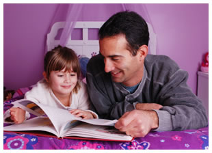 Father with young daughter reading a bedtime story