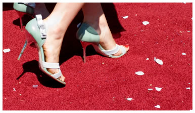 Female feet walking on the red carpet