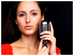 Female singer / voice talent holding a microphone