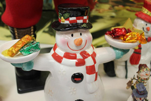 Frosty the Snowman, painted ceramic figurine holding chocolates in either hand just in time to share at Christmas in the Voices.com offices.