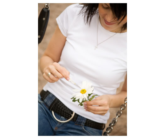 girl on swing plucking a daisy
