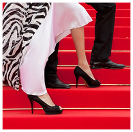 Glamorous celebrity feet stepping on the red carpet