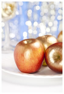 Golden apples on a silver setting