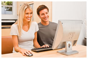 Happy couple using a computer
