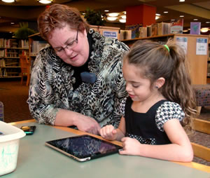 Julie Brandl at the London Public Library using the London ABCs app