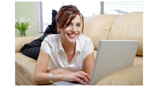 Lady on couch laptop smiling