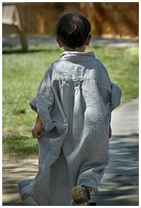 Little boy wearing an over-sized shirt