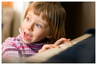 Little girl playing piano and singing