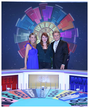 Lora Cain with Vanna White and Pat Sajak of Wheel of Fortune
