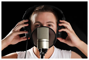 Man behind a microphone and pop filter