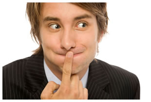 Man covering his mouth with his index finger