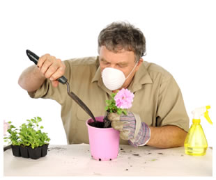 Man gardening and wearing a face mask