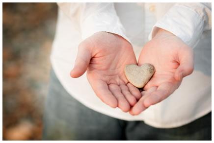 Man holding a heart-shaped rock