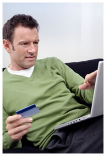 Man making a credit card payment online