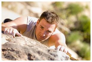 man-rock-climbing-overcoming-struggle.jpg