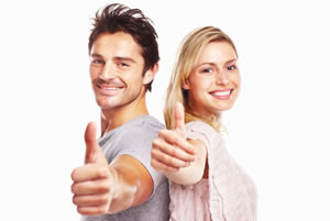 Man and woman standing back-to-back with thumbs up