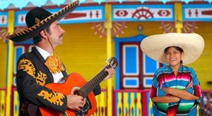 Mariachi man wearing a sombrero playing a guitar, woman watching with hands crossed over her chest, smiling. Mexican atmosphere, very colorful house in the background and colorful traditional dress.