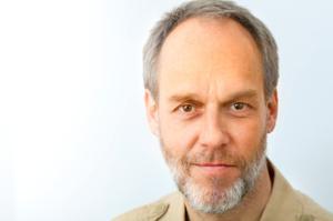 Mature man, smiling eyes, greying hair and beard