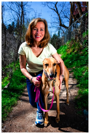 Mature woman walking a dog in the forest Don't want your read to get away on ...