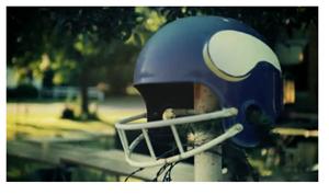 Minnesota Vikings NFL, helmet, purple, white viking horns, resting on a fencepost.
