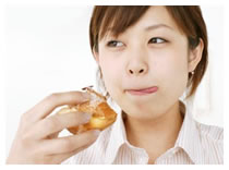 Asian woman eating