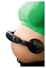 Pregnant woman wearing headphones