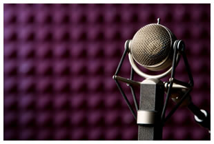 Purple soundproofing acoustic foam in studio with microphone