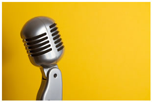 Retro microphone (silver) on yellow background