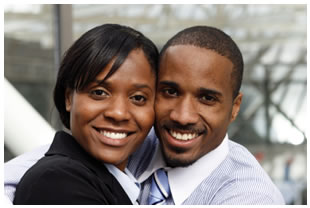 Smiling couple in business attire, African descent